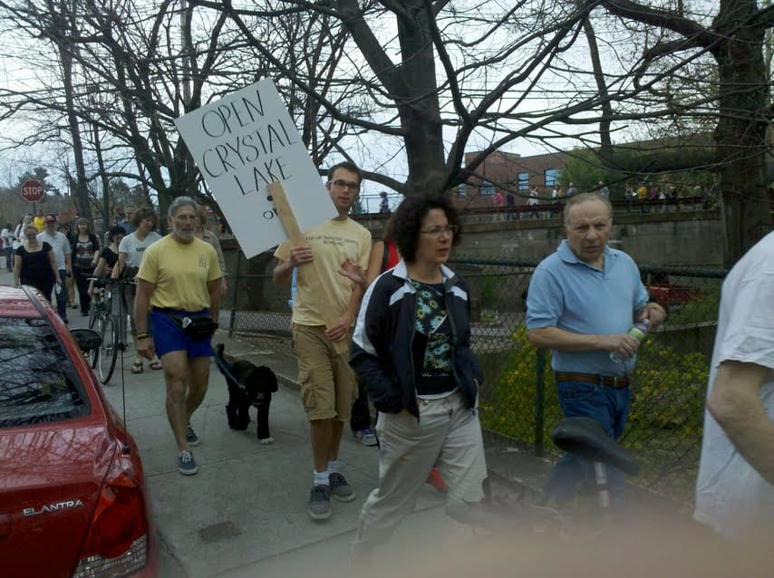 Protesters parade pond's periphery — but is there any solution for Crystal Lake??