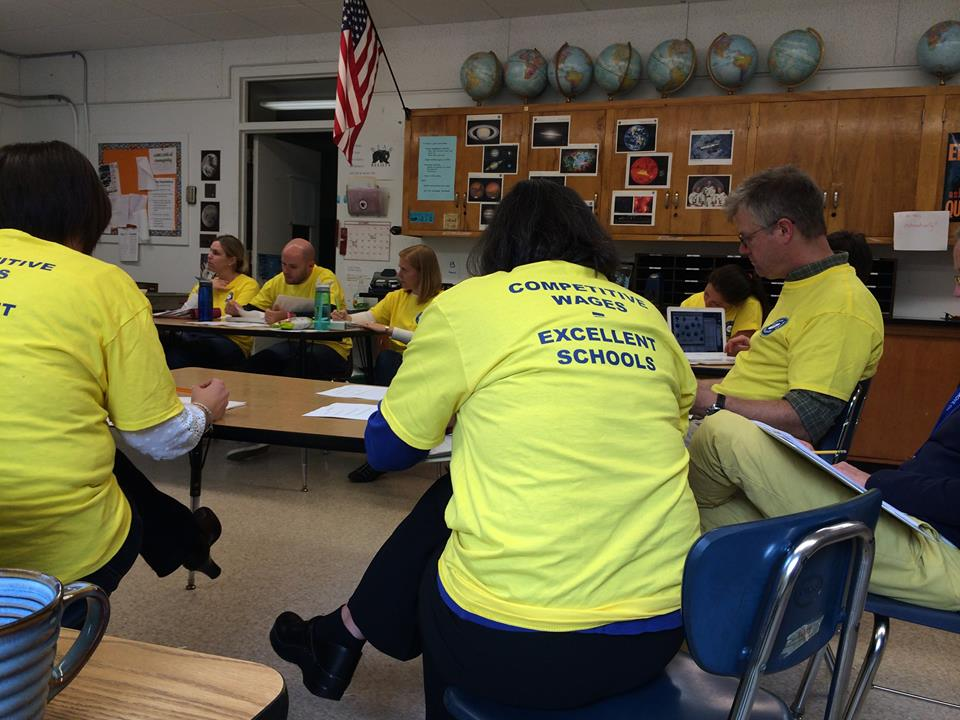 Newton South students and parents share views on the teacher and those yellow shirts